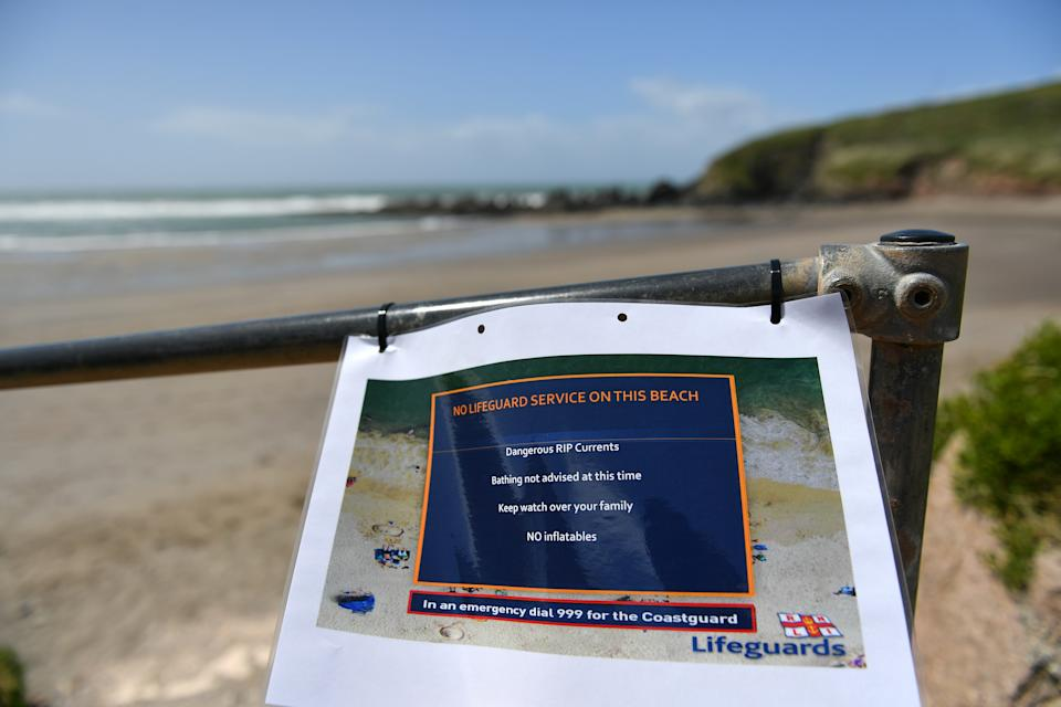 CHALLABOROUGH, ENGLAND - MAY 23: A warning notice is displayed informing visitors that there is no RNLI Lifeguards on duty on May 23, 2020 in Challaborough, England. The British government has started easing the lockdown it imposed two months ago to curb the spread of Covid-19, abandoning its 'stay at home' slogan in favour of a message to 'be alert', but UK countries have varied in their approaches to relaxing quarantine measures. (Photo by Dan Mullan/Getty Images)