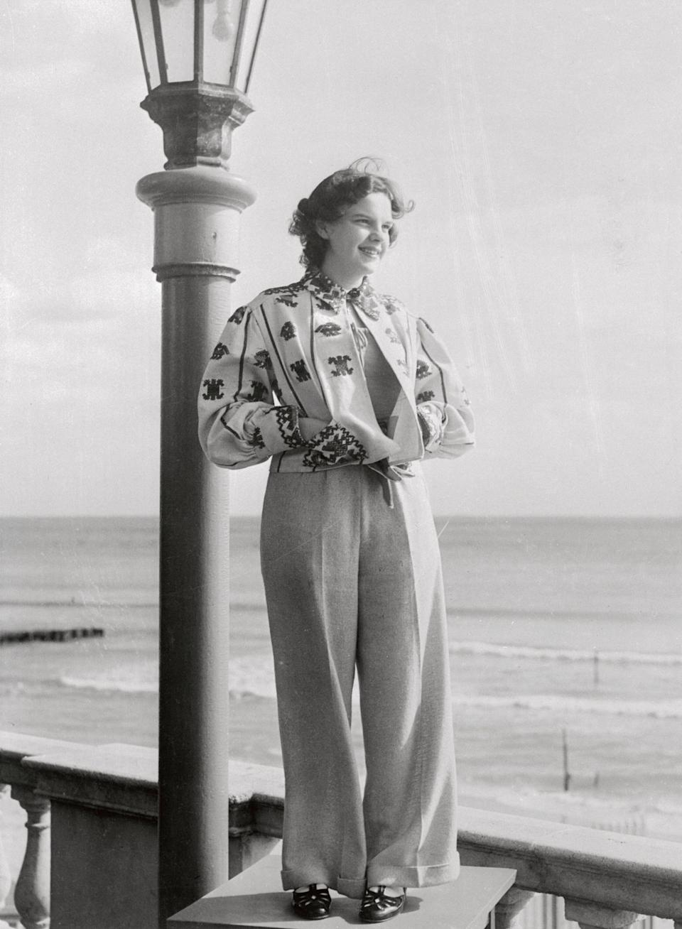 """Garland stands for a portrait at the Roney Plaza Cabana Sun Club in Miami around the time her film """"Everybody Sing"""" premiered."""