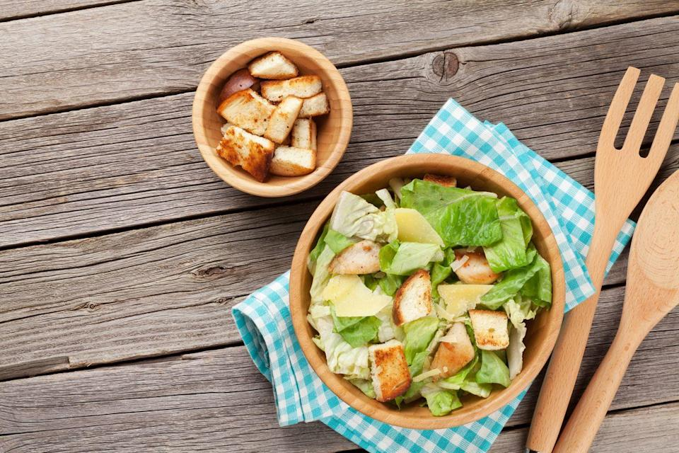 """<p>Ordering a salad is a smart way to sneak in more vegetables, true. But that bowl can be hiding sources of extra fat and calories, according to Mike Roussell, PhD, a nutrition consultant in Rochester, New York. </p><p>""""People will order salads because they think they're low in calories, but if it has creamy dressing, cheese, bacon, croutons and nuts, then you're getting a lot more calories than you'd guess,"""" Roussell says. Ask for the dressing on the side to control the quantity, then choose just two indulgent additions (for example, nuts and cheese).</p>"""
