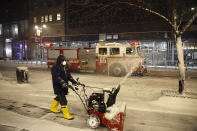 <p>A Midtown office worker clears the sidewalk as a fire truck passes on Wednesday night in N.Y.C.</p>