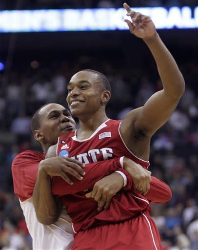 North Carolina State's Alex Johnson is embraced by a teammate after the team's 66-63 win over Georgetown in an an NCAA men's ollege basketball tournament third-round game Sunday, March 18, 2012, in Columbus, Ohio. (AP Photo/Jay LaPrete)