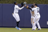 Miami Marlins left fielder Lewis Brinson, left, center fielder Starling Marte, center, and right fielder Adam Duvall (14) high-five after a baseball game against the San Diego Padres, Sunday, July 25, 2021, in Miami. The Marlins won 9-3. (AP Photo/Lynne Sladky)