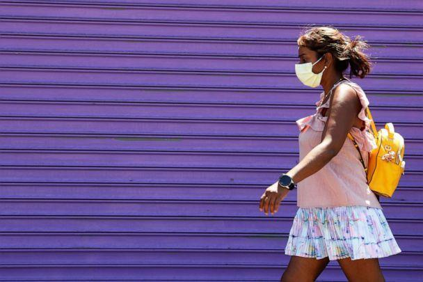 PHOTO: A woman wearing a protective face mask walks in New York, Aug. 3, 2020. (Shannon Stapleton/Reuters)