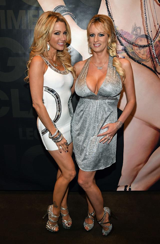Jessica Drake (left) and Stormy Daniels pose at the Wicked Pictures booth at an adult entertainment expo in Las Vegas in 2015.