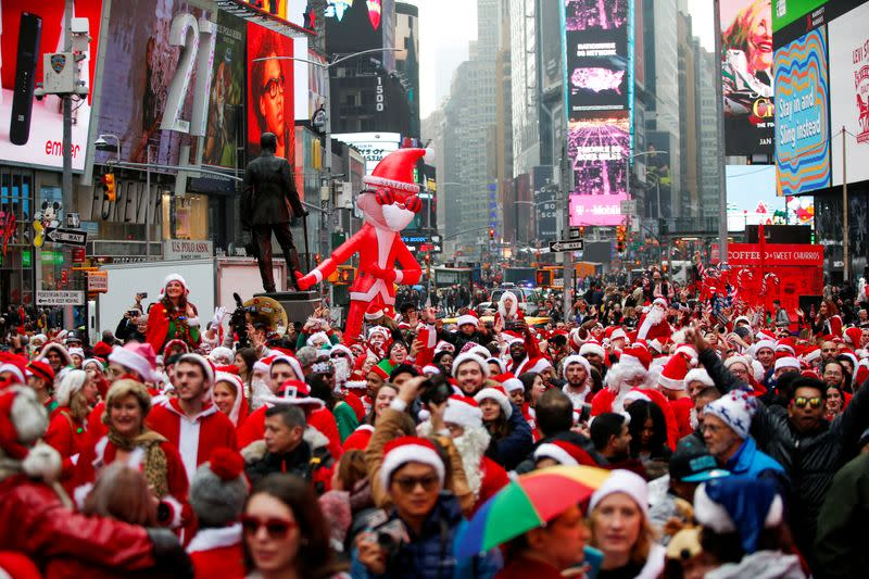 FILE PHOTO: Revelers dressed as Santa Claus take part in the event called SantaCon at Times Square in New York