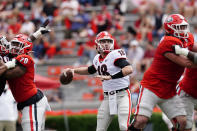Georgia quarterback JT Daniels (18) throws from the pocket during the first half in Georgia's spring NCAA college football game, Saturday, April 17, 2021, in Athens, Ga. (AP Photo/John Bazemore)
