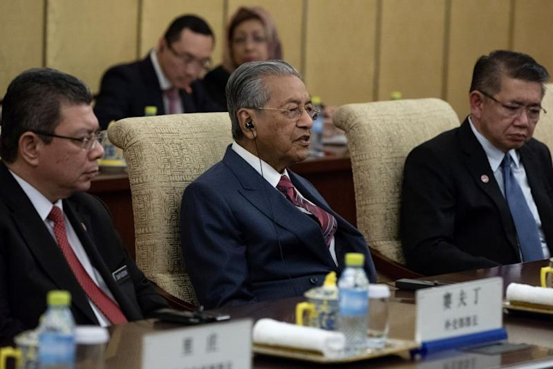 Dr Mahathir said contracts negotiated with Chinese companies for the ECRL and pipeline projects had no exit clauses so Malaysia has to pay out 'huge sums' in compensation. ― Reuters pic