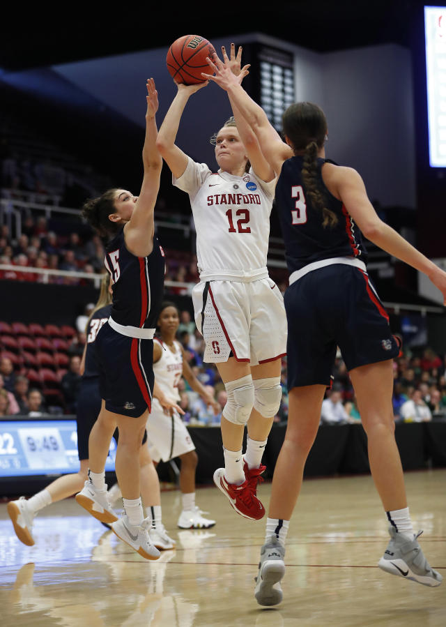 Stanford guard Brittany McPhee (12) takes a shot over Gonzaga guard Jessie Loera (15) and forward Jenn Wirth (3) during the first half of a first-round game in the NCAA women's college basketball tournament in Stanford, Calif., Saturday, March 17, 2018. (AP Photo/Tony Avelar)