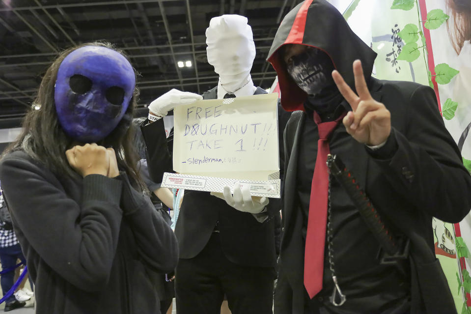 <p>A trio of masked cosplayers pose for the camera. (PHOTO: Don Wong) </p>