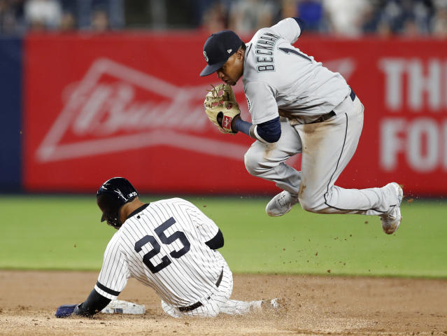 Seattle Mariners shortstop Tim Beckham (1) leaps after forcing out New York Yankees Gleyber Torres (25) after a grounder by Gio Urshela during the seventh inning of a baseball game Tuesday, May 7, 2019, in New York. (AP Photo/Kathy Willens)