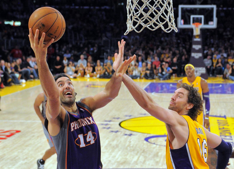Phoenix Suns forward Luis Scola, of Argentina, left, puts up a shot as Los Angeles Lakers forward Pau Gasol, of Spain, defends during the first half of their NBA basketball game, Friday, Nov. 16, 2012, in Los Angeles. (AP Photo/Mark J. Terrill)