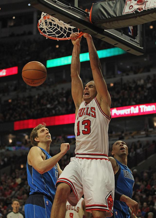 CHICAGO, IL - APRIL 21: Joakim Noah #13 of the Chicago Bulls dunks over Dirk Nowitzki #41 and Shawn Marion #0 of the Dallas Mavericks at the United Center on April 21, 2012 in Chicago, Illinois. The Bulls defeated the Mavericks 93-83. NOTE TO USER: User expressly acknowledges and agress that, by downloading and/or using this photograph, User is consenting to the terms and conditions of the Getty Images License Agreement. (Photo by Jonathan Daniel/Getty Images)