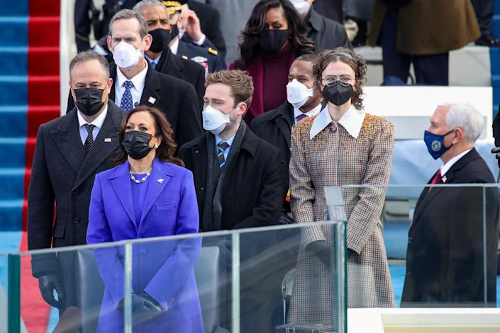 Doug Emhoff, Vice President Kamala Harris, Cole Emhoff, Ella Emhoff, and former Vice President Mike Pence stand as Lady Gaga arrives to sing the National Anthem at the inauguration on Jan. 20. (Photo: Rob Carr via Getty Images)