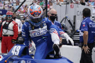 Tony Kanaan, of Brazil, climbs out of his car during qualifications for the Indianapolis 500 auto race at Indianapolis Motor Speedway, Saturday, May 22, 2021, in Indianapolis. (AP Photo/Darron Cummings)