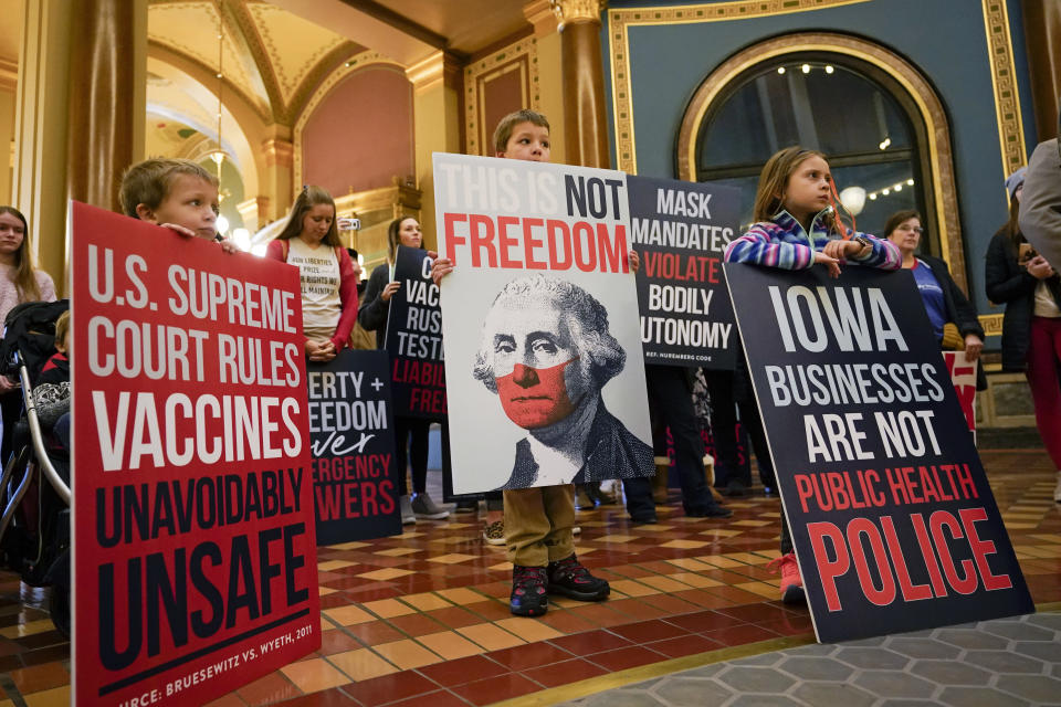 Protestors gather in the Iowa Capitol rotunda to voice their opposition to mask mandates, Monday, Jan. 11, 2021, at the Statehouse in Des Moines, Iowa. (AP Photo/Charlie Neibergall)
