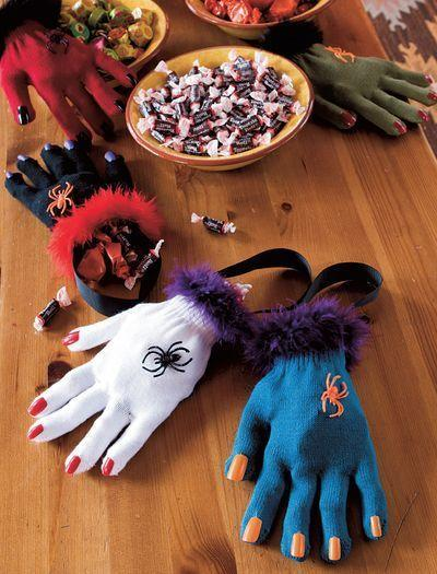 """<p>Fill gloves with your favorite little candies to make these cute witch hands. </p><p><strong><em><a href=""""https://www.womansday.com/home/crafts-projects/a28915338/hag-bags/"""" rel=""""nofollow noopener"""" target=""""_blank"""" data-ylk=""""slk:Get the Hag Bags tutorial"""" class=""""link rapid-noclick-resp"""">Get the Hag Bags tutorial</a>. </em></strong></p><p><a class=""""link rapid-noclick-resp"""" href=""""https://www.amazon.com/VATIN-Grosgrain-50-Yard-Wrapping-Projects/dp/B08BLDYV5D?tag=syn-yahoo-20&ascsubtag=%5Bartid%7C10070.g.2488%5Bsrc%7Cyahoo-us"""" rel=""""nofollow noopener"""" target=""""_blank"""" data-ylk=""""slk:SHOP BLACK RIBBON"""">SHOP BLACK RIBBON</a></p>"""