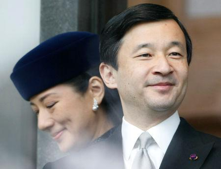 FILE PHOTO: Japan's Crown Prince Naruhito and Crown Princess Masako appear before well-wishers as they celebrate the emperor's 74th birthday in Tokyo