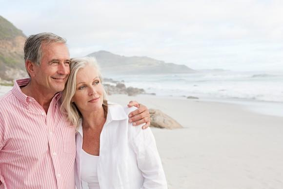 Man putting arm around woman at the beach
