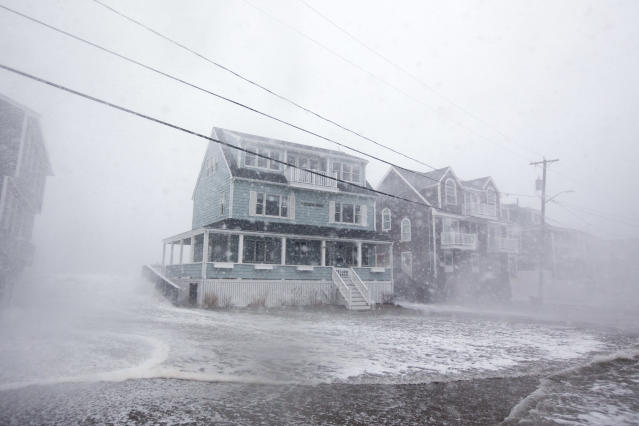 <p>Waves crash over a house on Lighthouse Rd. as the road starts to flood during a large coastal storm on March 2, 2018 in Scituate, Mass. (Photo: Scott Eisen/Getty Images) </p>
