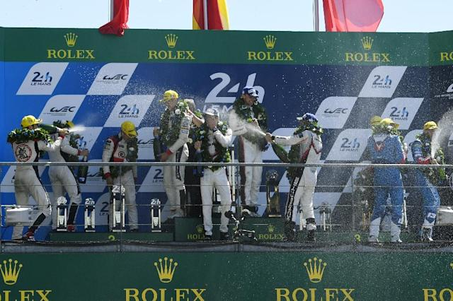Celebrations on the podium after the Le Mans 24 hours endurance race (AFP Photo/DAMIEN MEYER)