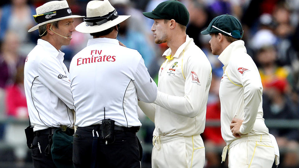 Cameron Bancroft and Steve Smith, pictured here speaking to umpires about the cheating attempts.