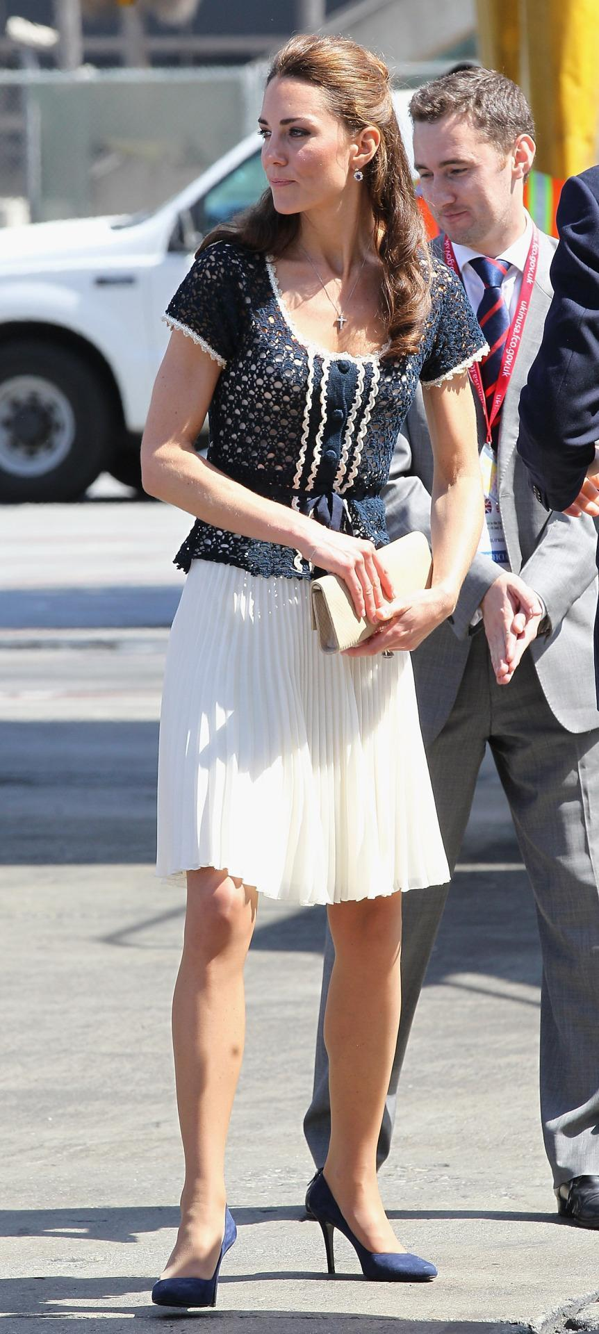 <p>Kate wore a white pleated skirt and knitted top (both from Whistles) for her last day in LA. She completed the look with navy pumps and an eggshell clutch.</p><p><i>[Photo: PA]</i></p>