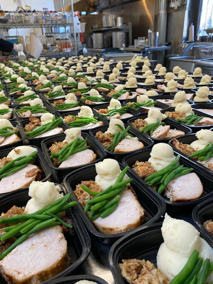 Big Delicious Planet of Chicago prepares 200 meals for donation to Thresholds clients.