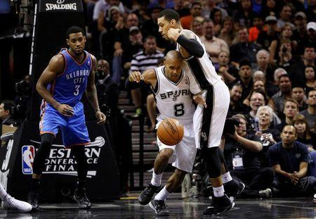 May 21, 2014; San Antonio, TX, USA; San Antonio Spurs guard Patrick Mills (8) brings the ball up court against the Oklahoma City Thunder in game two of the Western Conference Finals of the 2014 NBA Playoffs at AT&T Center. Soobum Im-USA TODAY Sports