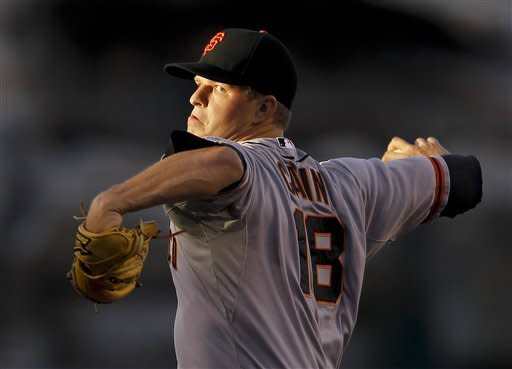 San Francisco Giants starting pitcher Matt Cain throws to the Los Angeles Angels during the first inning of a baseball game in Anaheim, Calif., Monday, June 18, 2012. (AP Photo/Chris Carlson)