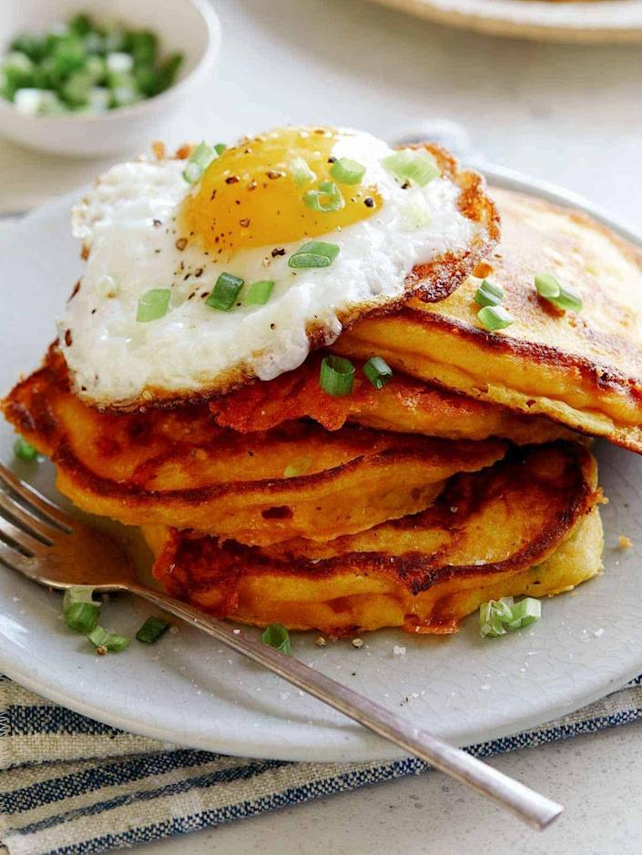 """<p>These cheesy pumpkin pancakes are loaded with grated cheddar and green onion, then topped with a runny fried egg.</p><p><strong>Get the recipe at <a href=""""https://www.spoonforkbacon.com/cheesy-pumpkin-and-green-onion-pancakes/"""" rel=""""nofollow noopener"""" target=""""_blank"""" data-ylk=""""slk:Spoon Fork Bacon"""" class=""""link rapid-noclick-resp"""">Spoon Fork Bacon</a>. </strong></p><p><a class=""""link rapid-noclick-resp"""" href=""""https://go.redirectingat.com?id=74968X1596630&url=https%3A%2F%2Fwww.walmart.com%2Fsearch%2F%3Fquery%3Dpioneer%2Bwoman%2Bcooking%2Btools&sref=https%3A%2F%2Fwww.thepioneerwoman.com%2Ffood-cooking%2Fmeals-menus%2Fg36729946%2Fsavory-pumpkin-recipes%2F"""" rel=""""nofollow noopener"""" target=""""_blank"""" data-ylk=""""slk:SHOP COOKING TOOLS"""">SHOP COOKING TOOLS</a></p>"""