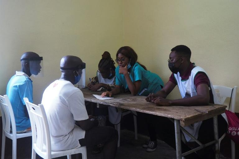 Consultation: ASCOVIME doctors talk to patients in Nkongsamba. Health services are sketchy and life expectancy is low in many parts of Cameroon