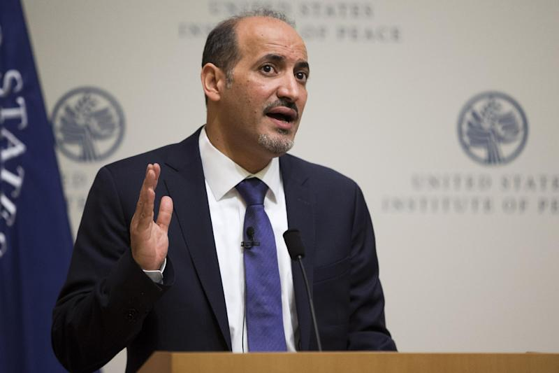 "President Ahmad al-Jarba, president of the National Coalition for Syrian Revolutionary and Opposition Forces, speaks at the U.S. Institute of Peace, on Wednesday, May 7, 2014, in Washington. Al-Jarba said that rebel forces need weapons that could ""neutralize'' aerial raids by President Bashar Assad's air force in order to change the balance of power on the ground and pave the way for a political solution to the crisis. (AP Photo/ Evan Vucci)"