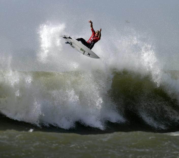 """<span class=""""caption"""">Hawaiian surfer John John Florence, seen here competing in Portugal, is one of the favorites to win surfing's first Olympic gold. </span> <span class=""""attribution""""><a class=""""link rapid-noclick-resp"""" href=""""https://newsroom.ap.org/detail/PortugalSurf/28db9b5fff044e9186c7db8caa8d855f/photo?Query=surfing%20john%20florence&mediaType=photo&sortBy=&dateRange=Anytime&totalCount=18&currentItemNo=0"""" rel=""""nofollow noopener"""" target=""""_blank"""" data-ylk=""""slk:AP Photo/Francisco Seco"""">AP Photo/Francisco Seco</a></span>"""