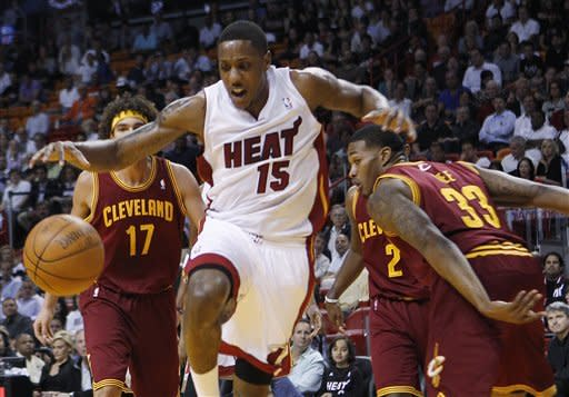 Miami Heat's Mario Chalmers (15) loses the ball as Cleveland Cavaliers' Alonzo Gee (33) defends during the first half of an NBA basketball game, Tuesday, Jan. 24, 2012, in Miami. (AP Photo/Lynne Sladky)
