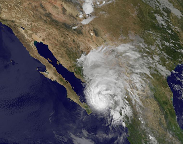 This image provided by NOAA shows Hurricane Manuel taken at 3:45 a.m. EDT Thursday Sept. 19, 2013. The U.S. National Hurricane Center said Manuel was a Category 1 hurricane hugging Mexico's coast early Thursday and expected to produce 75 mph winds and between 5 and 10 inches of rain over the state of Sinaloa. (AP Photo/NOAA)