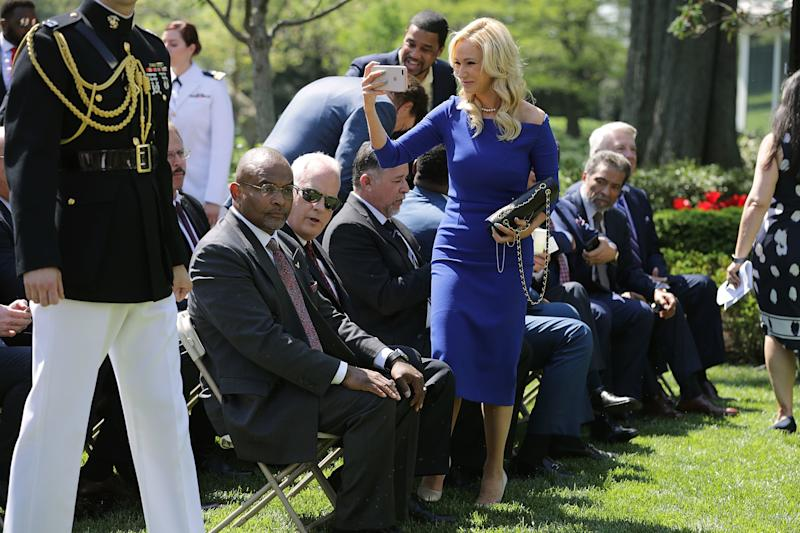 White takes photos duringa National Day of Prayer event in the Rose Garden onMay 3, 2018. (Chip Somodevilla via Getty Images)