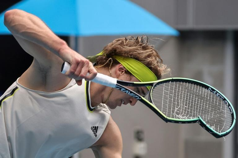 Germany's Alexander Zverev smashes his racquet against Marcos Giron