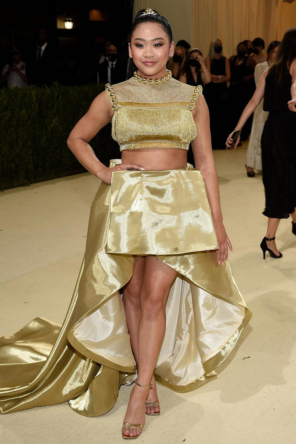 <p>Just like the gold medal she won in Tokyo, gymnast Sunisa Lee was golden on Monday night in a crop top and skirt by Sukeina.</p>