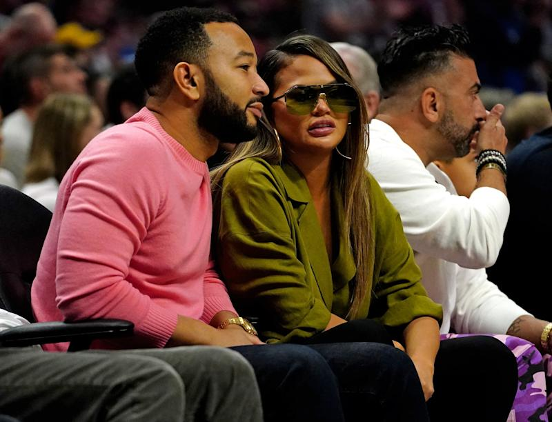 Harassment: Legend and Teigen are frequently targetted by thousands of Twitter accounts (Reuters)
