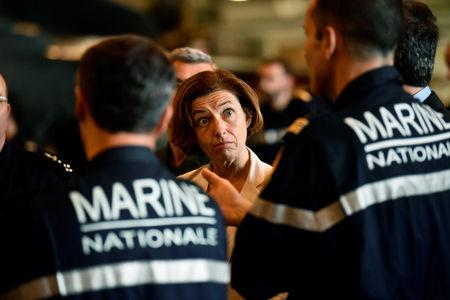 """FILE PHOTO - French Defence Minister Florence Parly stands with marine officers as she visits the aircraft carrier """"Charles de Gaulle"""", on the occasion of the completion of its 18 month-long renovation in Toulon"""