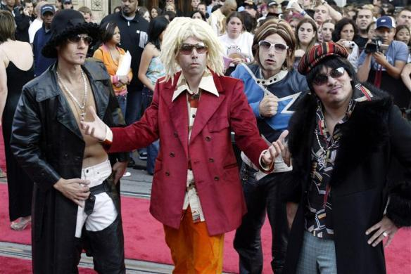 The Beastie Boys pose on the red carpet prior to the Much Music Video Awards in Toronto, June 20, 2004.