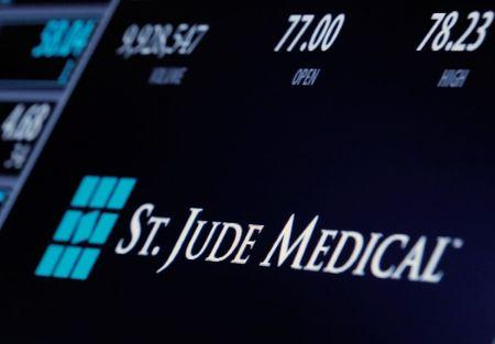 The ticker and trading information for St. Jude Medical is displayed where the stock is traded on the floor of the NYSE