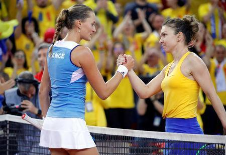Tennis - Fed Cup - World Group Semi-Final - France v Romania - Kindarena, Rouen, France - April 20, 2019 Romania's Simona Halep and France's Kristina Mladenovic shake hands after their match REUTERS/Charles Platiau