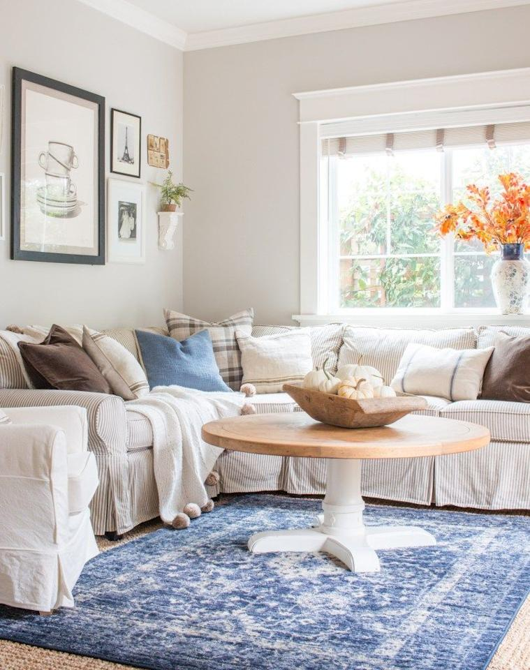 "<p>It really doesn't take much to get your home into the fall spirit! A bright pop of color, like the vase of fall leaves seen here, does a lot to warm up everyday decor. A cozy throw and bowl of white pumpkins further the feel. </p><p><em>See more at <a href=""https://www.sawnailandpaint.com/2018/10/06/cozy-and-collected-fall-den/"" target=""_blank"">Saw Nail & Paint.</a></em></p><p><a class=""body-btn-link"" href=""https://www.amazon.com/Rinlong-Artificial-Branches-Yellow-Branch/dp/B07H4RYTSD/?tag=syn-yahoo-20&ascsubtag=%5Bartid%7C10072.g.28212915%5Bsrc%7Cyahoo-us"" target=""_blank"">SHOP FALL BRANCHES</a></p>"