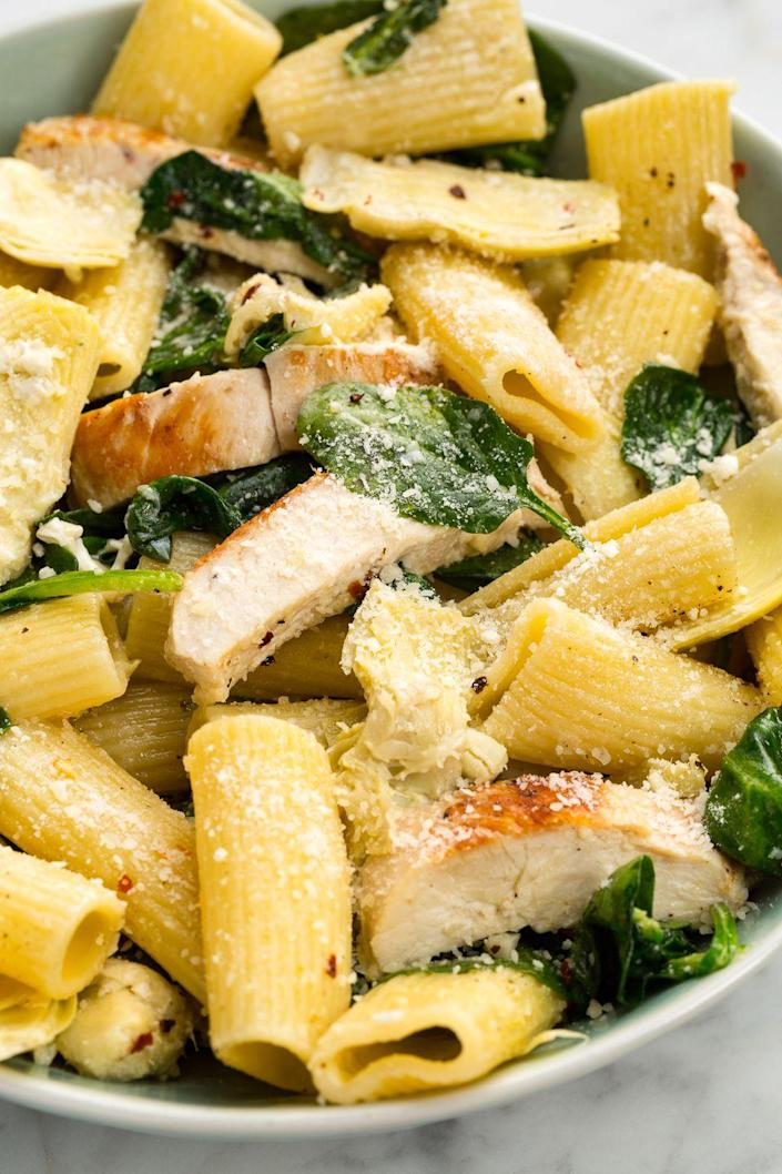 """<p>Your favorite dip deconstructed as a pasta? Yes, please.</p><p>Get the recipe from <a href=""""https://www.delish.com/cooking/recipe-ideas/recipes/a46527/chicken-spinach-and-artichoke-rigatoni-recipe/"""" rel=""""nofollow noopener"""" target=""""_blank"""" data-ylk=""""slk:Delish"""" class=""""link rapid-noclick-resp"""">Delish</a>. </p>"""