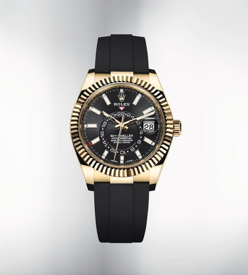 """<p><strong>Rolex</strong></p><p>rolex.com</p><p><strong>$2020.00</strong></p><p><a href=""""https://www.rolex.com/watches/sky-dweller/m326238-0009.html"""" rel=""""nofollow noopener"""" target=""""_blank"""" data-ylk=""""slk:Shop It"""" class=""""link rapid-noclick-resp"""">Shop It</a></p><p>The stunning Sky-Dweller has been reinvented for 2020 with an Oysterflex bracelet made of high-performance elastomer, plus, all the other features you love about the earlier model. It's perfect for the globe-trekker in your life, as its second time zone display makes it easy to determine the time at one's home or usual workplace and clearly distinguishes day from nighttime hours. </p>"""