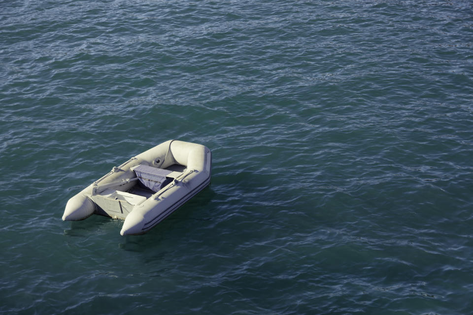 Small inflatable boat out at sea.