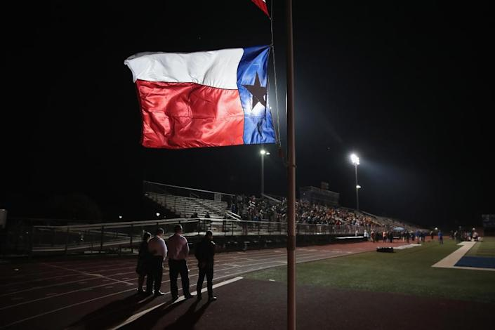 A Texas flag flies at half mast during a prayer services at the La Vernia High School Football stadium to grieve the 26 victims killed at the First Baptist Church of Sutherland Springs on November 7, 2017 in La Vernia, Texas.