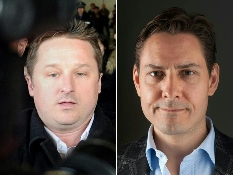 Canadian businessman Michael Spavor (L) and Canadian diplomat Michael Kovrig were reunited with their families in Canada (AFP/WANG Zhao, Julie DAVID DE LOSSY)