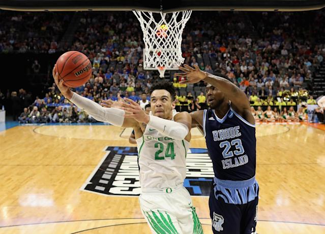 <p>Dillon Brooks #24 of the Oregon Ducks drives to the basket against Kuran Iverson #23 of the Rhode Island Rams during the second round of the 2017 NCAA Men's Basketball Tournament at Golden 1 Center on March 19, 2017 in Sacramento, California. (Photo by Jamie Squire/Getty Images) </p>